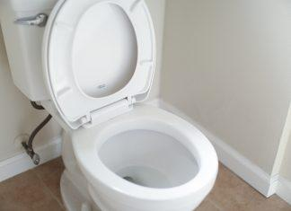 white ceramic toilet bowl with cover