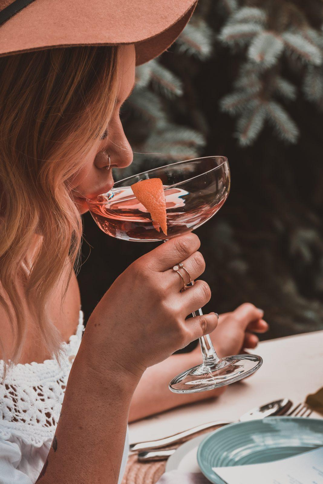 woman holding cocktail glass